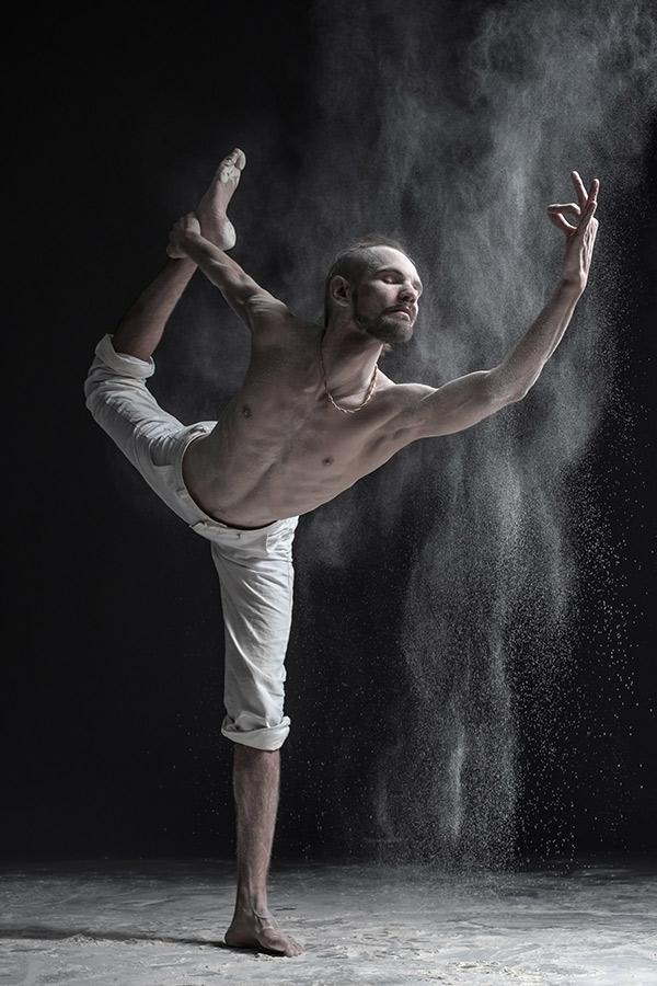 flexible-yoga-man-practices-yoga-or-pilates-perfor-PBJ8AVT