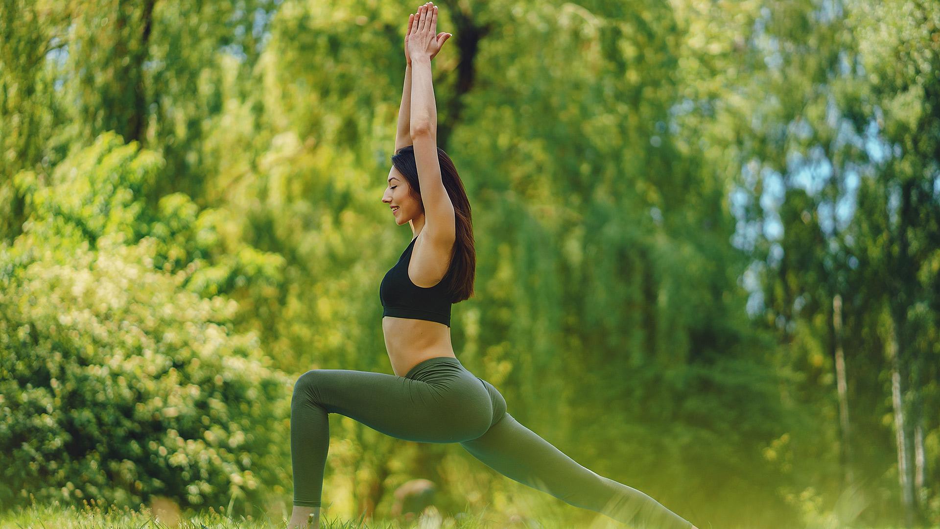 girl-practicing-yoga-BU7CPRW