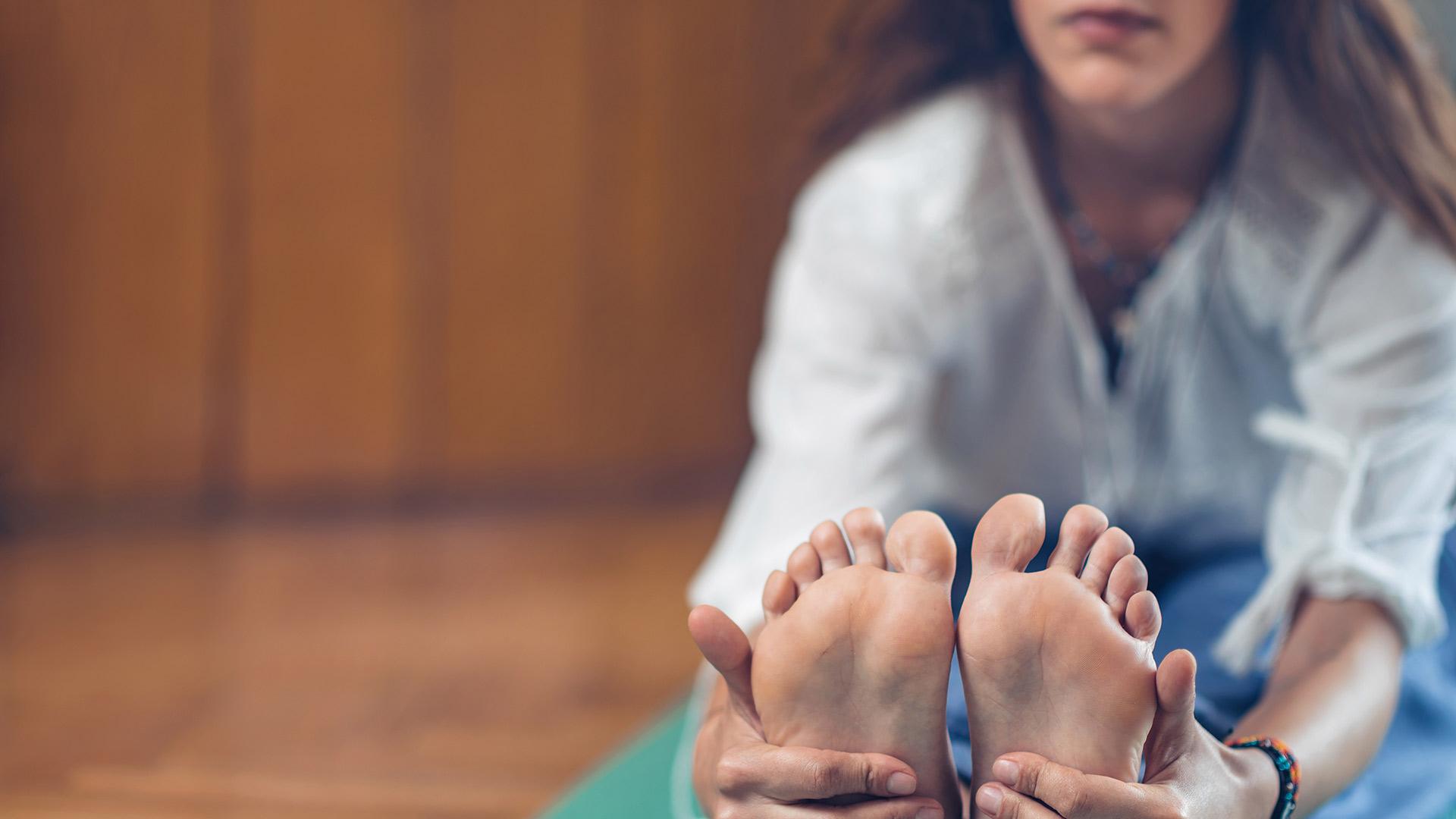 yoga-woman-in-yoga-studio-seated-forward-bend-QGHN9S5